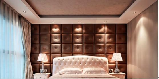 深咖啡色的软皮包床背景墙,白色的皮床背显得很时尚霸气